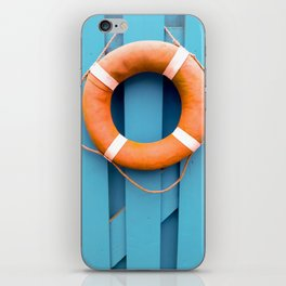 Summer holidays. Orange lifeguard over a blue wooden gate iPhone Skin