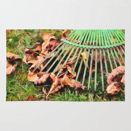 Raking the fallen autumn leaves Rug