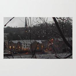 Raindrops illuminated by the sleepy town Rug