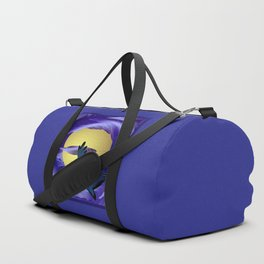 A bird in the moonlight. Bird Flying through the clouds to the moon toward the holiday Halloween. Duffle Bag