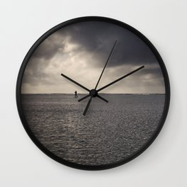 Paddler before the storm. Wall Clock
