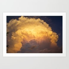 Sunset behind clouds Art Print