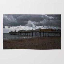 Dark Clouds Over Paignton Pier Rug