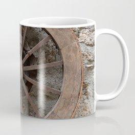 Wooden wheel hanging on a stone wall Coffee Mug