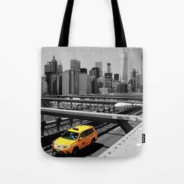 Yellow cab on Brooklyn Bridge, Manhattan, New York, USA. Tote Bag