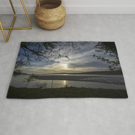 Sunset on a river Rug