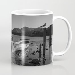 a black and white image of rowing boats moored at derwentwater Coffee Mug