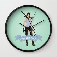 lara croft Wall Clocks featuring Fight Like a Girl: Lara Croft by Dorothy Leigh