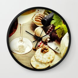Wine, grape and cheese on wooden background Wall Clock