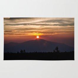 Sunrise in the mountain Rug