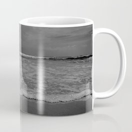 A lonely sea shell in the surf of Assateague Island (black and white) Coffee Mug