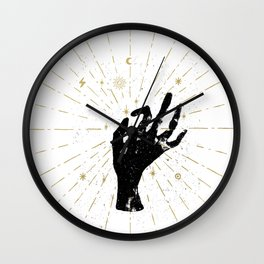 Black witch's hand with light rays Wall Clock