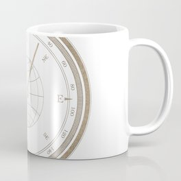 Gold Compass on White Coffee Mug