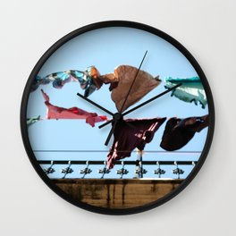 Hanging laundry in blowing wind Wall Clock