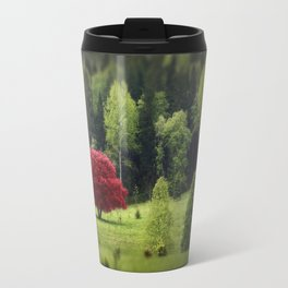 Unique red tree in a meadow of green trees Travel Mug