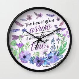 The heart is an arrow Wall Clock