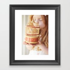 A girl and her bird Framed Art Print