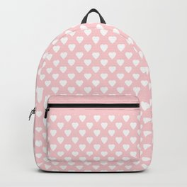 White hearts on a light pink background . Backpack