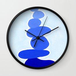 Rock balancing in blue Wall Clock