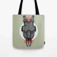 animal skull Tote Bags featuring ANIMAL SKULL by Stefania Grippaldi - IDEAS FLY studio
