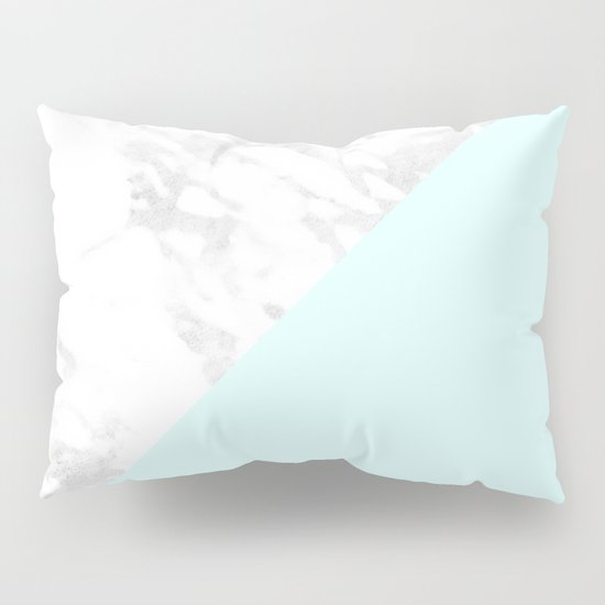 white marble with pastel blue and grey pillow sham