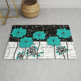 Turquoise flowers on black and white background . Rug