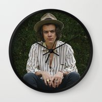 harry styles Wall Clocks featuring Harry Styles by behindthenoise