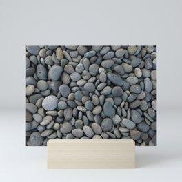 Gray pebbles Mini Art Print