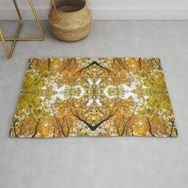 Abstract mirrored autumn nature photography collage in yellow and orange  Rug