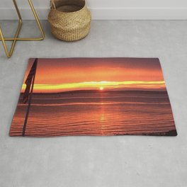 Sunset Over the Ocean Rug
