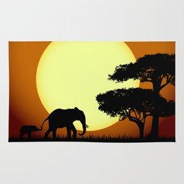 Safari elephants at sunset Rug