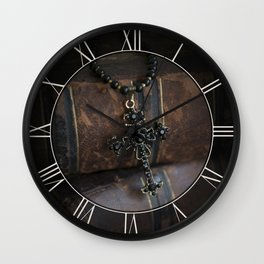 Black cross pendant and old books Wall Clock