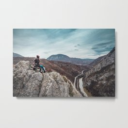 Girl sitting on the bench on the edge of the canyon with amazing view in front of her Metal Print