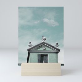 Mint Building on Aqua with Clouds and Sculptures Mini Art Print