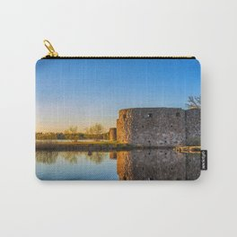 Ruins of old scandinavian castle or fort at sunset time at the lake Carry-All Pouch