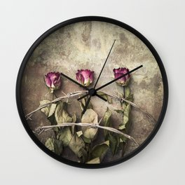 Three dried roses and barbed wire Wall Clock