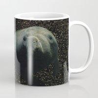 manatee Mugs featuring Cosmic Manatee by Ashley Eyster