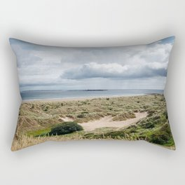 A dramatic sea view over sand dunes and wild grass onto Bamburgh beach, Northumberland, England Rectangular Pillow