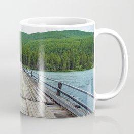 Wooden bridge across mountain stream. Altai Republic, Russia. Coffee Mug
