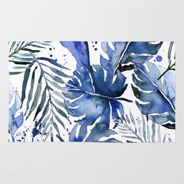 Tropical plants in indigo blue Rug