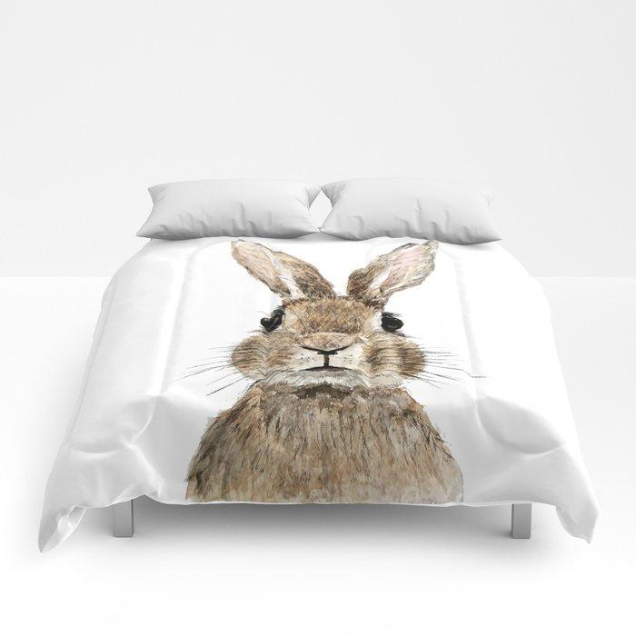 cute innocent rabbit Comforters