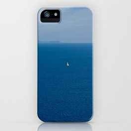 Boat in the blue sea iPhone Case