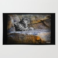 snow leopard Area & Throw Rugs featuring Snow Leopard by Jennifer Rose Cotts Photography