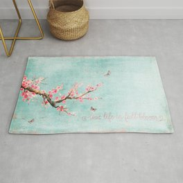 Live life in full bloom - Romantic Spring Cherry Blossom butterfly Watercolor illustration on teal Rug