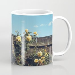 Yellow flowers over a wooden fence Coffee Mug