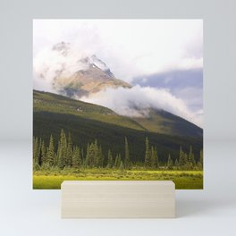 Rocky Mountains Shrouded in Breathtaking Clouds With Meadow Mini Art Print