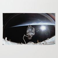 nasa Area & Throw Rugs featuring NASA International Space Station by Planet Prints
