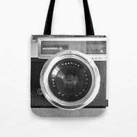 red Tote Bags featuring Camera by Nicklas Gustafsson