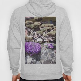 Rock Retaining Wall With Beautiful Trees and Purple Flowers Hoody
