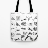 animal skull Tote Bags featuring Animal Skull Alphabet by Stephan Brusche